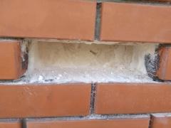 Утеплення пустотілих стін